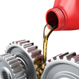oil being poured over tarmission gears Change a Lawn Mowers oil, how often?
